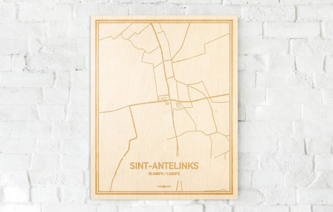 De kaart Sint-Antelinks aan een witte bakstenen muur. Prachtige persoonlijke muurdecoratie. Lasers graveren Sint-Antelinks haar straten, buurten en huizen waardoor een originele plaats in Oost-Vlaanderen  mooi in kaart gebracht wordt.