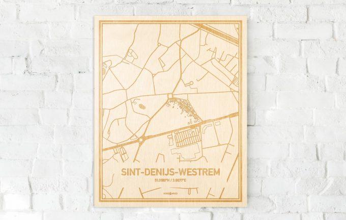 De kaart Sint-Denijs-Westrem aan een witte bakstenen muur. Prachtige persoonlijke muurdecoratie. Lasers graveren Sint-Denijs-Westrem haar straten, buurten en huizen waardoor een verrassende plaats in Oost-Vlaanderen  mooi in kaart gebracht wordt.