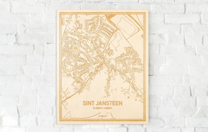 De kaart Sint Jansteen aan een witte bakstenen muur. Prachtige persoonlijke muurdecoratie. Lasers graveren Sint Jansteen haar straten, buurten en huizen waardoor een originele plaats in Zeeland mooi in kaart gebracht wordt.