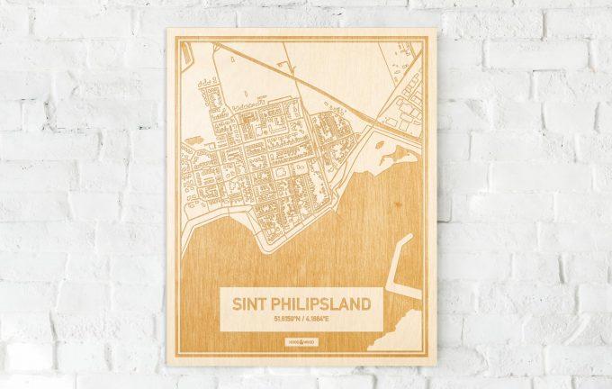De kaart Sint Philipsland aan een witte bakstenen muur. Prachtige persoonlijke muurdecoratie. Lasers graveren Sint Philipsland haar straten, buurten en huizen waardoor een moderne plaats in Zeeland mooi in kaart gebracht wordt.