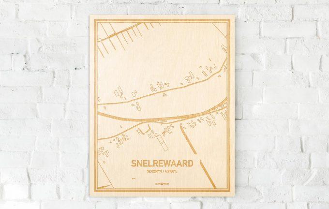De kaart Snelrewaard aan een witte bakstenen muur. Prachtige persoonlijke muurdecoratie. Lasers graveren Snelrewaard haar straten, buurten en huizen waardoor een moderne plaats in Utrecht mooi in kaart gebracht wordt.