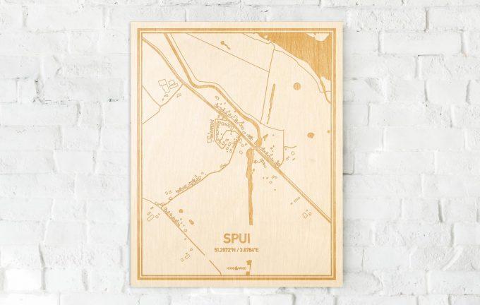 De kaart Spui aan een witte bakstenen muur. Prachtige persoonlijke muurdecoratie. Lasers graveren Spui haar straten, buurten en huizen waardoor een originele plaats in Zeeland mooi in kaart gebracht wordt.