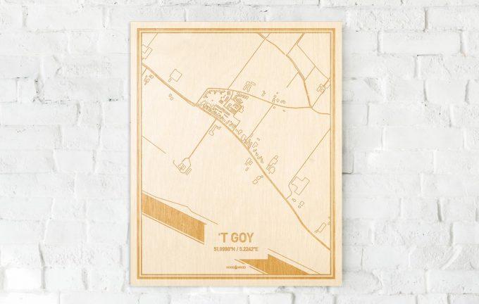 De kaart 't Goy aan een witte bakstenen muur. Prachtige persoonlijke muurdecoratie. Lasers graveren 't Goy haar straten, buurten en huizen waardoor een prachtige plaats in Utrecht mooi in kaart gebracht wordt.