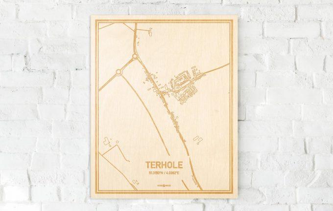 De kaart Terhole aan een witte bakstenen muur. Prachtige persoonlijke muurdecoratie. Lasers graveren Terhole haar straten, buurten en huizen waardoor een verrassende plaats in Zeeland mooi in kaart gebracht wordt.