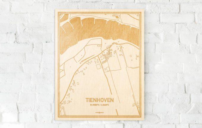 De kaart Tienhoven aan een witte bakstenen muur. Prachtige persoonlijke muurdecoratie. Lasers graveren Tienhoven haar straten, buurten en huizen waardoor een prachtige plaats in Utrecht mooi in kaart gebracht wordt.