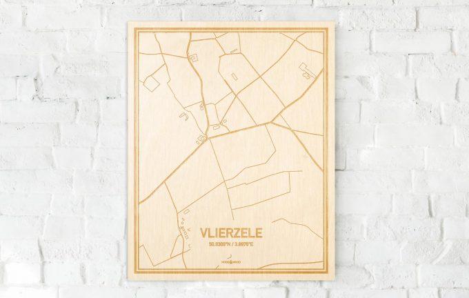 De kaart Vlierzele aan een witte bakstenen muur. Prachtige persoonlijke muurdecoratie. Lasers graveren Vlierzele haar straten, buurten en huizen waardoor een speciale plaats in Oost-Vlaanderen  mooi in kaart gebracht wordt.