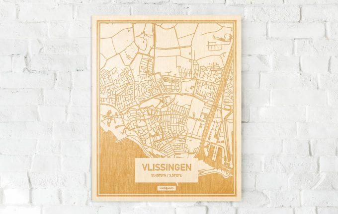 De kaart Vlissingen aan een witte bakstenen muur. Prachtige persoonlijke muurdecoratie. Lasers graveren Vlissingen haar straten, buurten en huizen waardoor een prachtige plaats in Zeeland mooi in kaart gebracht wordt.