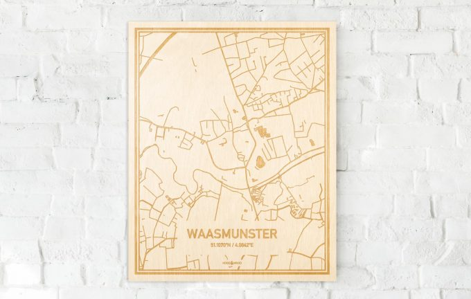 De kaart Waasmunster aan een witte bakstenen muur. Prachtige persoonlijke muurdecoratie. Lasers graveren Waasmunster haar straten, buurten en huizen waardoor een opvallende plaats in Oost-Vlaanderen  mooi in kaart gebracht wordt.