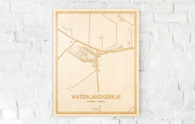 De kaart Waterlandkerkje aan een witte bakstenen muur. Prachtige persoonlijke muurdecoratie. Lasers graveren Waterlandkerkje haar straten, buurten en huizen waardoor een speciale plaats in Zeeland mooi in kaart gebracht wordt.