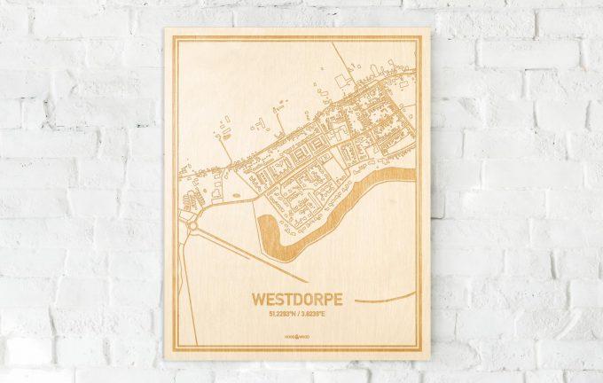 De kaart Westdorpe aan een witte bakstenen muur. Prachtige persoonlijke muurdecoratie. Lasers graveren Westdorpe haar straten, buurten en huizen waardoor een speciale plaats in Zeeland mooi in kaart gebracht wordt.