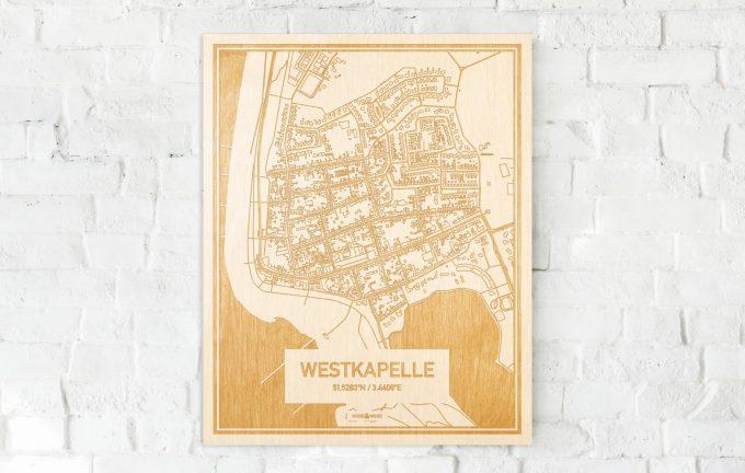 De kaart Westkapelle aan een witte bakstenen muur. Prachtige persoonlijke muurdecoratie. Lasers graveren Westkapelle haar straten, buurten en huizen waardoor een schitterende plaats in Zeeland mooi in kaart gebracht wordt.